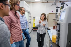31932D, CRI innovators lab: Chain Reaction Innovation entreprenuers Justin Whiteley and Tyler Huggins work with Argonne scientist Meltem Urgun-Demirtas in an Energy Systems Division laboratory to grow tunable, high-performance porous carbon from fungi. (Sokamrint Chak, post-doc)