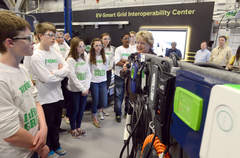 Students from Infinite Green program listen to Anne Schlenker, Director of the Center for Transporation Research during a tour of the Ev-Smart Grid Interoperability Center at Argonne National Laboratories in Lemont , IL on Tuesday April 30, 2013. | Matt Marton~Sun-Times Media